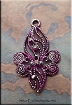 Ornate Fleur d'Lys Charm with Fuchsia Pink Patina