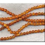 6mm Round Orange and Black Swirl Glass Beads