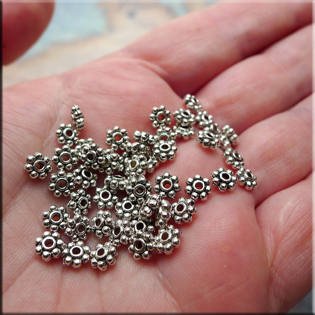 Silver Pewter Daisy Spacers 5mm 50 per bag